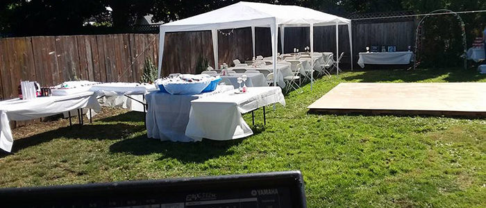 Events by Kdub; DJ Microphone; Event DJ Microphone up close; Various music; white wedding pop up setup for rain